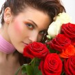 Beautiful young woman with roses  — Stock Photo