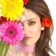 Beautiful young woman with flowers — Stock Photo #9550121