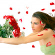 Beautiful young woman with red roses — Stock Photo #9550129
