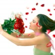 Stock Photo: Beautiful young woman with red roses