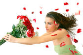 Beautiful young woman with red roses — Stock Photo