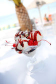 Ice cream in glass bowl with chocolate sauce and cherry — Stock Photo