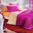 Colorful female bedroom - Stockfoto