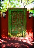 Green ancient frontdoor. — Stock Photo