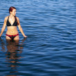 Young woman relaxing in sea - 