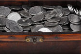 Treasure chest full of coins — Stock Photo