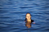 Young woman relaxing in sea — Stock Photo