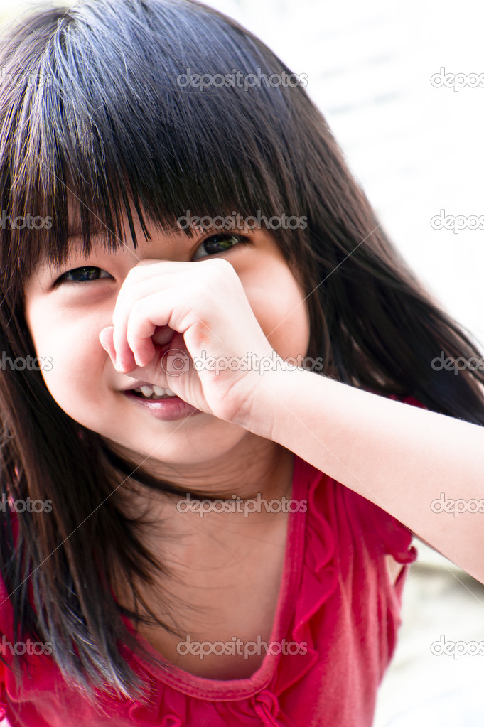 A playful asian girl covering her nose pretending she is a pig — Stock Photo #9025061