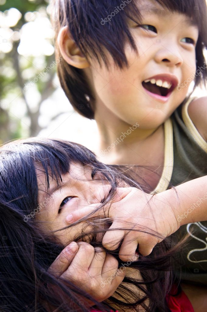 Asian Sibling, brother and sister playing wrestling with brother winning — Foto Stock #9025069