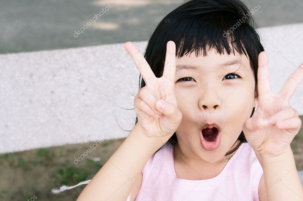 Mischievous pink girl in a victory pose. — Stock Photo #9069761