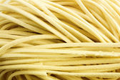 Uncooked Yellow Noodles — Stock Photo