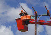 Linemen at work — Stock Photo