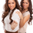 Stock Photo: The two girls - GEMINI show a credit card on a white background