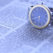 Wrist  watch over newspaper — Stock Photo