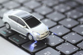Car model over keyboard — Stock Photo