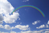 Rainbow and cloud in blue sky — Stock Photo