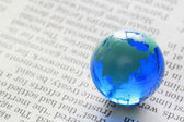 Earth on newspaper — Stock Photo