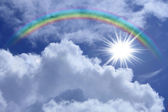 Rainbow against blue sky — Stockfoto