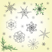 Delicate hand-drawn snowflakes set — Stock Vector
