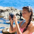 Girl with a camcorder — Stock Photo