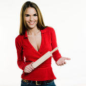 Beautiful brunette caucasian woman on white background holding a rolling pin — Stock Photo