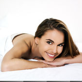 Woman lying on a bed — Stock Photo