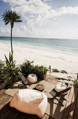 Terrace of a cabana on beach with bean bag chair — Stock Photo
