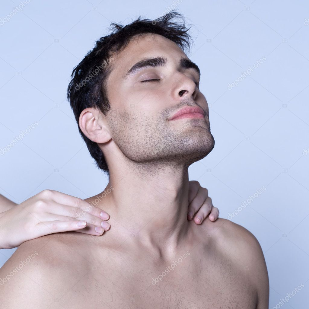 Studio shot on isolated background of a handsome man having a massage — Stock Photo #10149406