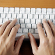 Royalty-Free Stock Photo: Woman hands typing on a keyboard computer
