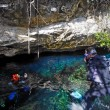 Stock Photo: Scubdivers in cenote