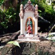 Small mexican virgin mary statue — Stock Photo