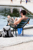 Tourist resting and reading — Stock Photo