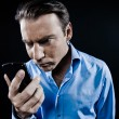 Stock Photo: MPortrait Angry looking at telephone videophone smartphone