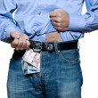 Detail of denim jeans with money inside - Stock Photo
