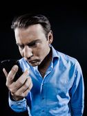 Man Portrait Angry looking at telephone videophone smartphone — Stock Photo