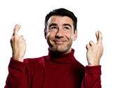 Caucasian man finger crossed gesture — Stock Photo