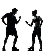 One couple man woman exercising workout fitness — Zdjęcie stockowe