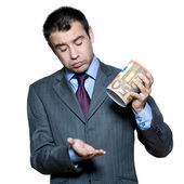 Portrait of businessman holding money box — Stock Photo