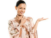 Portrait of cute Asian woman showing invisible product — Stock Photo
