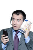 Portrait of shocked businessman with phone and money box — Stockfoto