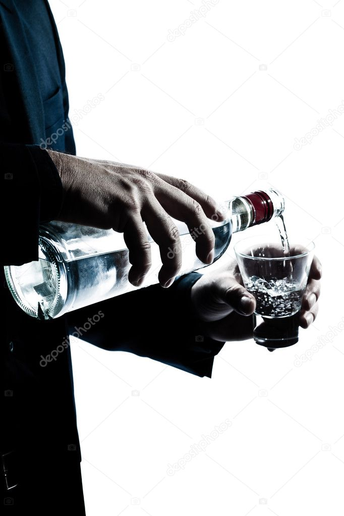 One caucasian man hands close up pouring white alcohol in a glass silhouette in studio isolated white background — Zdjęcie stockowe #8913357