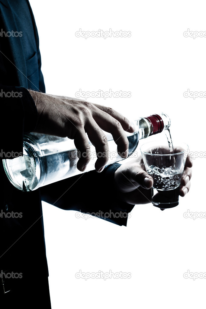 One caucasian man hands close up pouring white alcohol in a glass silhouette in studio isolated white background   #8913357