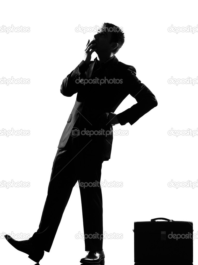 Silhouette caucasian business man thinking pensive behavior  looiking up full length on studio isolated white background  Stock Photo #8913519
