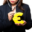 Closeup of woman examining euro — Stockfoto