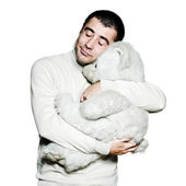 Man hugging teddy bear with eyes closed — Stock Photo