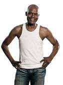Portrait of handsome smiling african man with hands on waist — Stockfoto