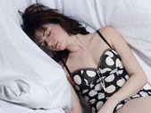 Woman in bed awakening — Stock Photo