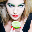 Woman Portrait show a citrus fruit — Stockfoto