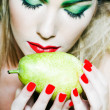 Woman portrait smelling a pear — Stock Photo #9000710