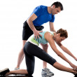 Man aerobic trainer positioning woman Workout — Stock Photo #9001895